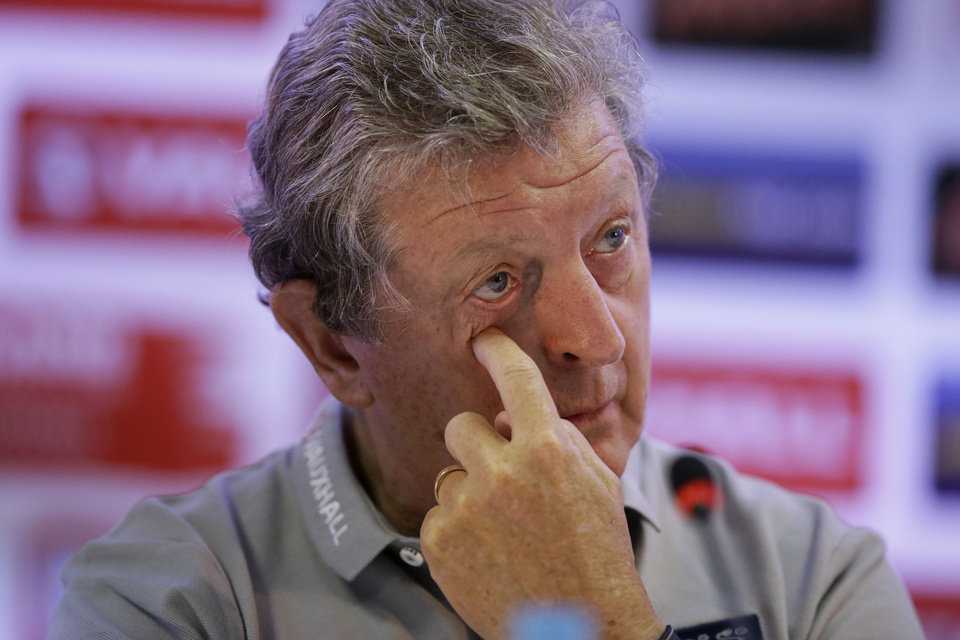 Photo - England national soccer team head coach Roy Hodgson touches his face during a press conference after a squad training session that was closed to the media for the 2014 soccer World Cup at the Urca military base in Rio de Janeiro, Brazil, Sunday, June 22, 2014.  Costa Rica's surprise 1-0 win over Italy on Friday meant that England made its most humiliating exit from a World Cup since 1958, following consecutive defeats by the Italians and then Uruguay in Group D.  England play Costa Rica in their final Group D match on Tuesday.  (AP Photo/Matt Dunham)