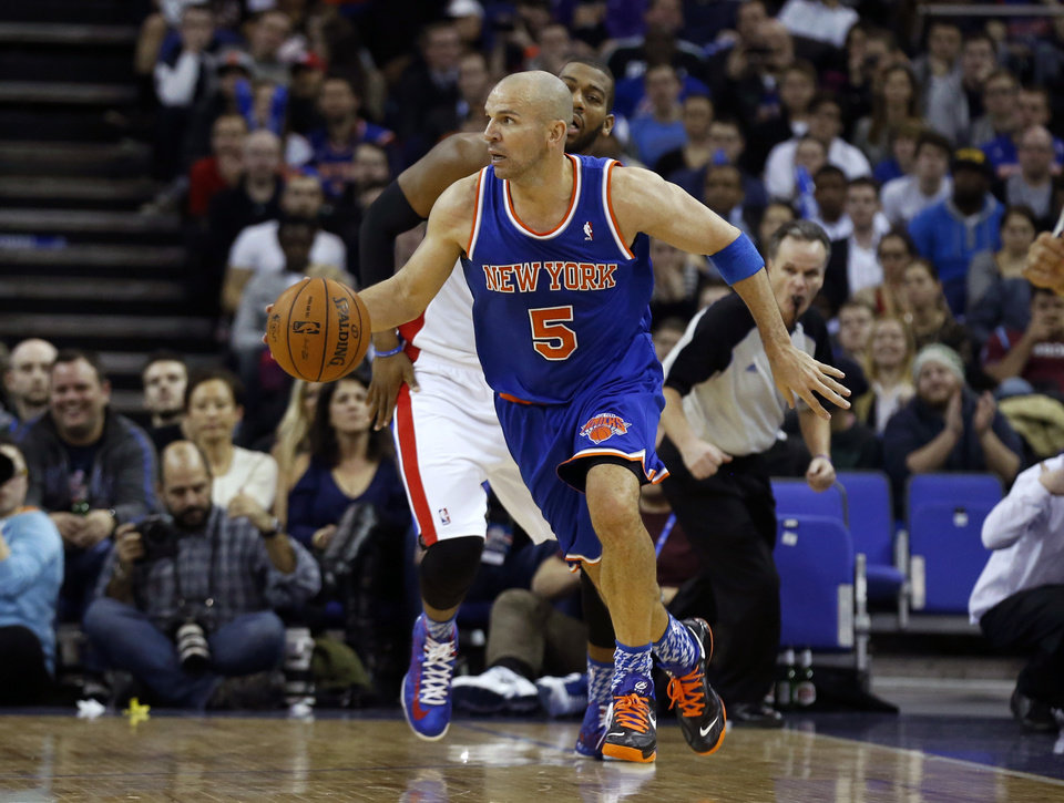 New York Knicks guard Jason Kidd (5) runs with the ball watched by Detroit Pistons center Greg Monroe, behind, during their NBA basketball game at the 02 arena in London, Thursday, Jan. 17, 2013.  (AP Photo/Matt Dunham)
