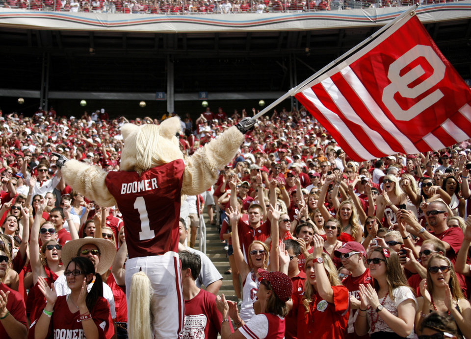 Photo - OU mascot Boomer wave a flag in front of fans during the Red River Rivalry college football game between the University of Oklahoma Sooners (OU) and the University of Texas Longhorns (UT) at the Cotton Bowl in Dallas, Saturday, Oct. 8, 2011. Oklahoma won 55-17. Photo by Bryan Terry, The Oklahoman