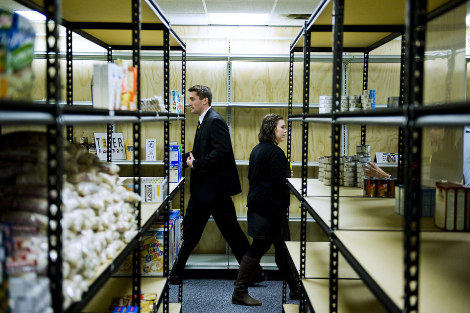 In this Oct. 1, 2012 photo, Nick Droege, left, founder of Tiger Pantry food pantry for students, and Amanda Gray, operations coordinator for Tiger Pantry, walk through the facility during an opening ceremony in Columbia, Mo. The food pantry will serve students in need of assistance in the Columbia area. (AP Photo/Columbia Daily Tribune, August Kryger)