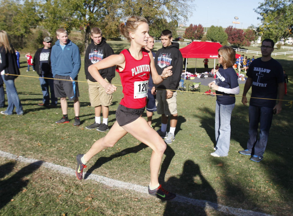 Photo - Plainview's Alex Davis takes an early lead during the class 3A girls State cross country meet at Gordon Cooper Vo-Tech in Shawnee, OK, Saturday, October 20, 2012. She went on to win the 3A meet.  By Paul Hellstern, The Oklahoman