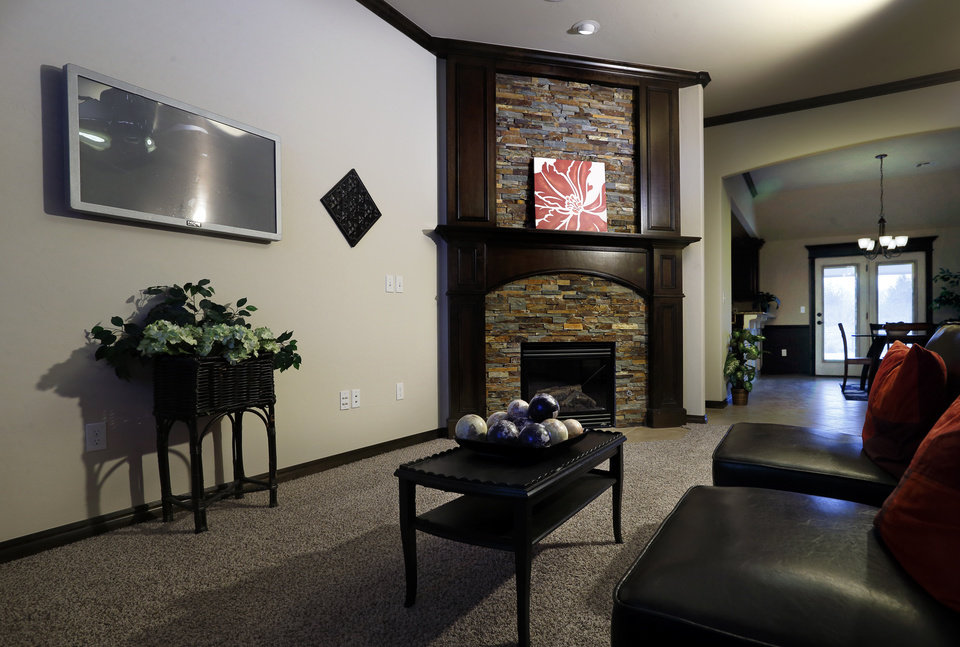 Photo - A flat-screen TV accents but does not dominate the living area of the home by First Oklahoma Construction at 709 Summit Hollow Drive in Norman.  STEVE SISNEY -