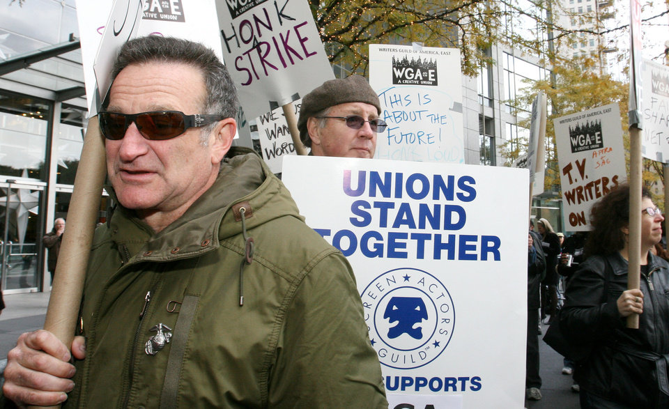 Photo - Actor Robin Williams, left, marches in the picket line with others during the fourth day of a strike by television and film writers, Thursday Nov. 8, 2007 at the Time Warner Center in New York. (AP Photo/Tina Fineberg) ORG XMIT: NYTF101