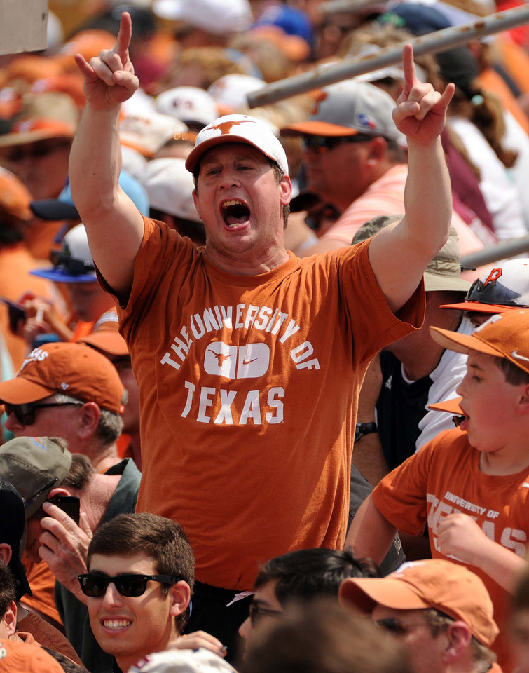 Photo - A fan of the Texas Longhorns cheers after Brooks Marlow's solo home run during the first  inning of an NCAA college baseball regional game against Texas A&M, Friday, May 30, 2014, in Houston. (AP Photo/Houston Chronicle, Eric Christian Smith)