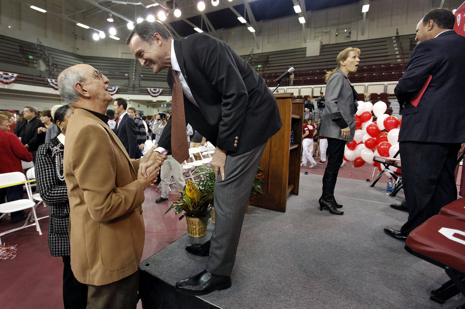 New University of Oklahoma men's basketball coach Lon Kruger speaks to fan Jerry Kershaw after a pep assembly that introduced Kruger as the new University of Oklahoma men's basketball coach on Monday, April 4, 2011, in Norman, Okla.