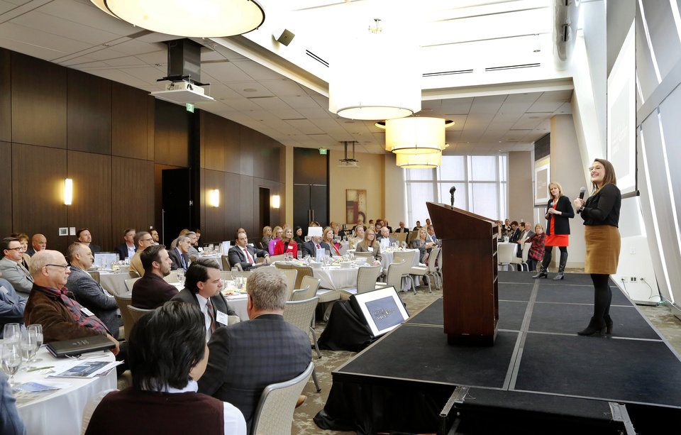 Photo -  Presentation on social media strategies during Commercial Real Estate Council of Oklahoma City annual meeting, at Vast, on Thursday, Feb. 28, 2019. [JIM BECKEL/THE OKLAHOMAN]