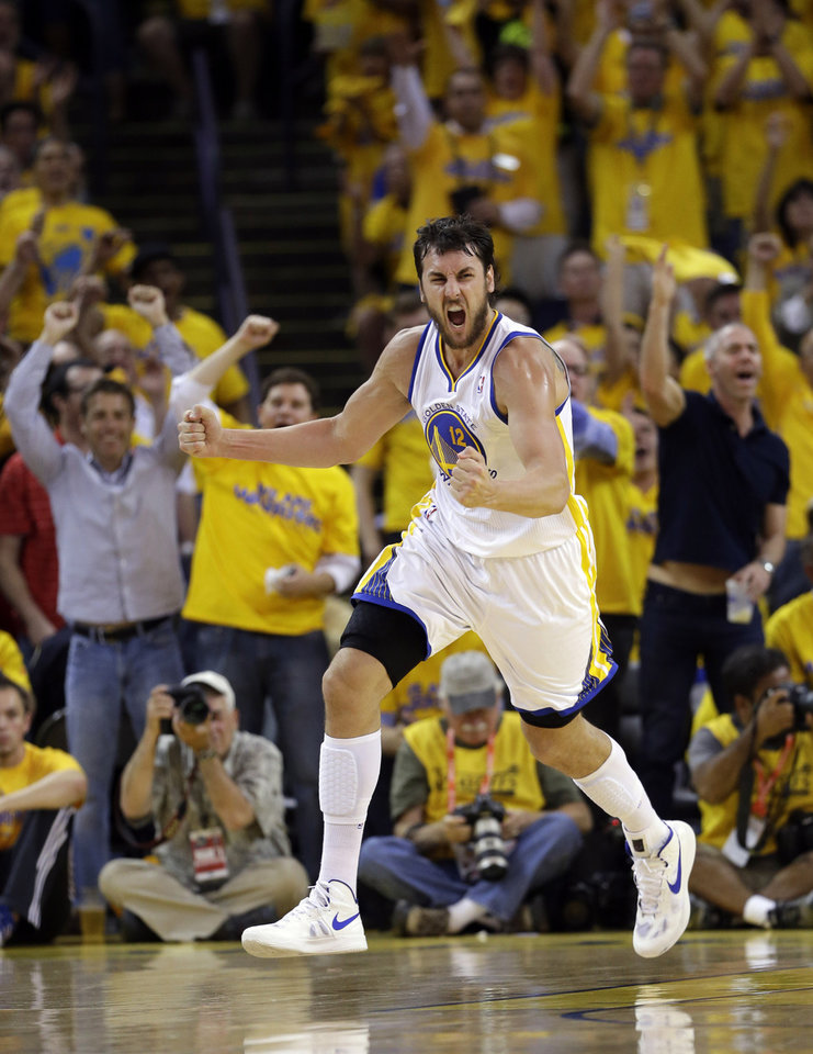 Photo - Golden State Warriors' Andrew Bogut celebrates after scoring against the Denver Nuggets during the second half of Game 6 in a first-round NBA basketball playoff series in Oakland, Calif., Thursday, May 2, 2013. Golden State won 92-88. (AP Photo/Marcio Jose Sanchez)