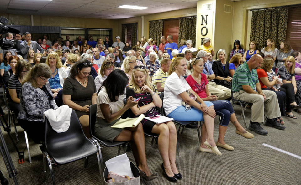 Photo -  A crowd gathers Tuesday for a Noble Board of Education meeting to decide Superintendent Ronda Bass' employment status in Noble. Bass came under fire for what many called inappropriate enforcement of the school's dress code. Photos by Bryan Terry, The Oklahoman   Bryan Terry -  THE OKLAHOMAN