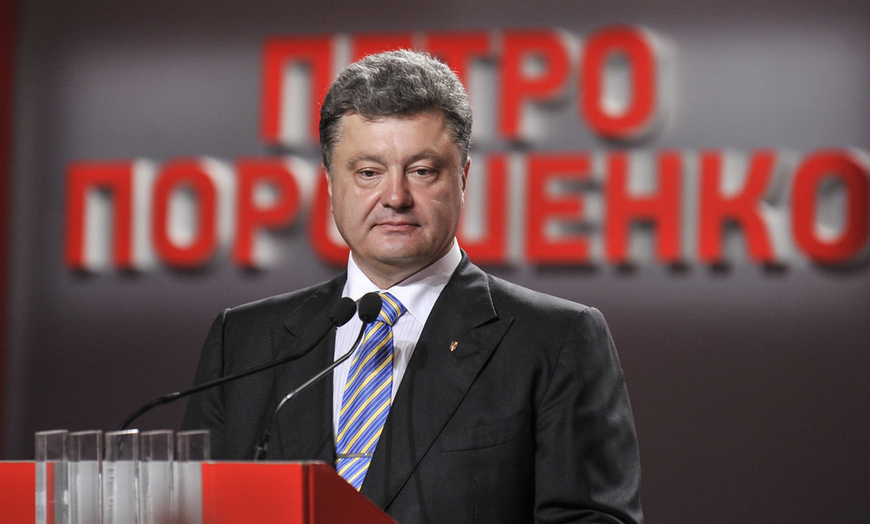 Photo - Ukrainian presidential candidate Petro Poroshenko during his press conference in Kiev, Ukraine, Sunday, May 25, 2014. An exit poll showed that billionaire candy-maker Petro Poroshenko won Ukraine's presidential election outright Sunday in the first round — a vote that authorities hoped would unify the fractured nation. The text reads