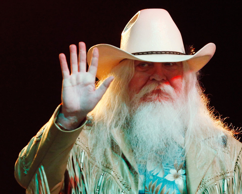 Photo - Leon Russell waves to his fans in the crowd before he leaves the stage at the end of his concert. Lawton,  Oklahoma native Leon Russell performed nearly 90 minutes of non-stop hits for an enthusiastic audience at the Chesapeake Energy Stage at the Oklahoma State Fair,   Friday,night, Sep. 16, 2011. The Rock and Roll Hall of Famer's performance is thought to be his first showcase at the fair.   Photo by Jim Beckel, The Oklahoman  ORG XMIT: KOD