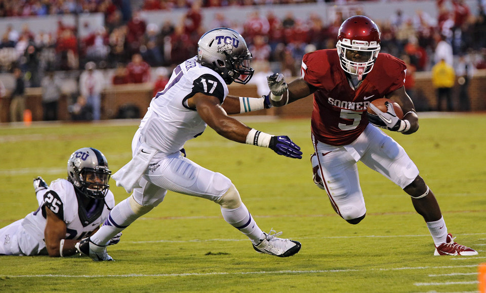 Oklahoma's Durron Neal (5) runs past TCU 's Sam Carter (17) during the college football game between the University of Oklahoma Sooners (OU) and the Texas Christian University Horned Frogs (TCU) at the Gaylord Family-Oklahoma Memorial Stadium on Saturday, Oct. 5, 2013 in Norman, Okla.   Photo by Chris Landsberger, The Oklahoman