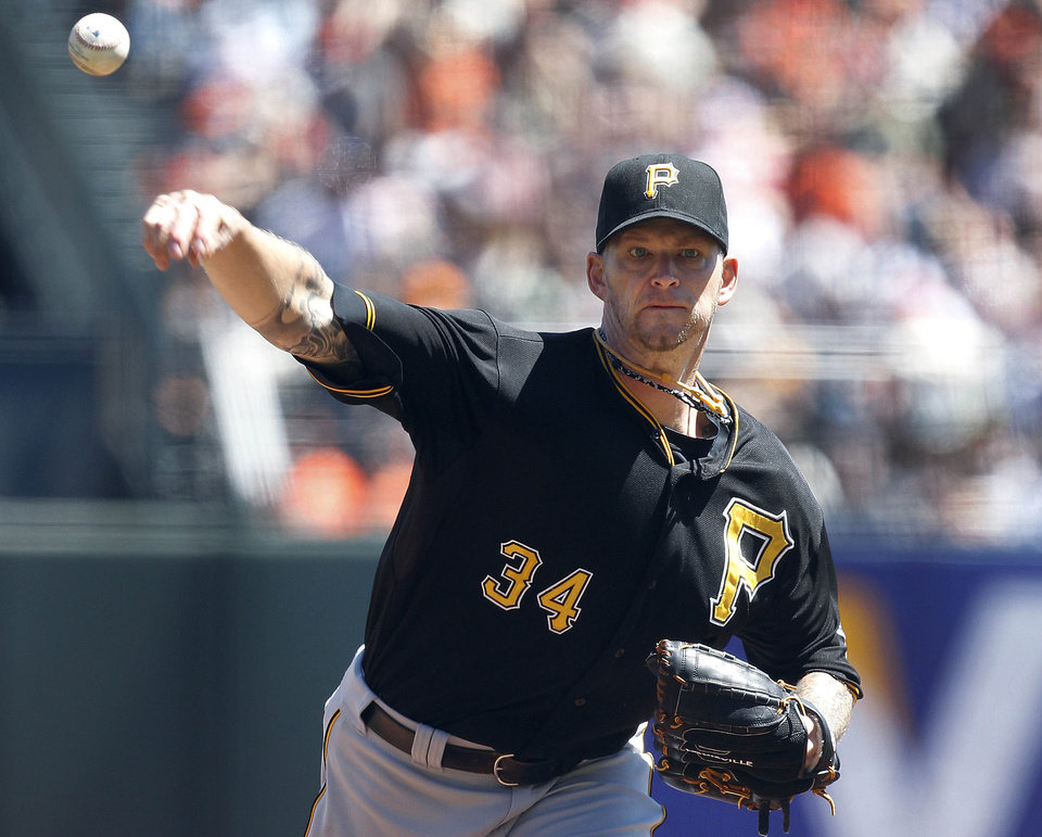 Pittsburgh Pirates starting pitcher A.J. Burnett throws against the San Francisco Giants in the first inning of a baseball game in San Francisco, Sunday, Aug. 25, 2013. (AP Photo/Tony Avelar)