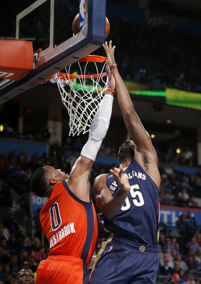 Photo - New Orleans' E'Twaun Moore (55) shoots over Oklahoma City's Russell Westbrook (0) during the NBA game between the Oklahoma City Thunder and the New Orleans Pelicans at the Chesapeake Energy Arena,  Sunday, Dec. 4, 2016. Photo by Sarah Phipps, The Oklahoman