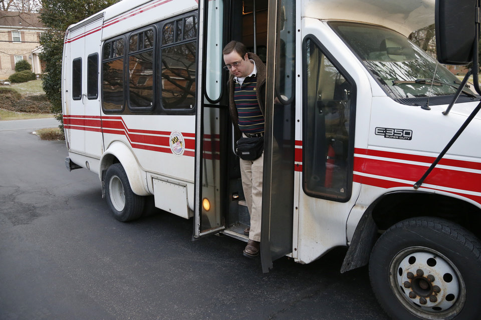 This photo taken Feb. 10, 2014 shows Matthew McMeekin getting off a bus at his home in Bethesda, Md. as he returns from work. Most Americans with intellectual or developmental disabilities remain shut out of the workforce, despite changing attitudes and billions spent on government programs to help them. Even when they find work, it�s often part time, in a dead-end job or for pay well below the minimum wage. McMeekin, 35, of Bethesda, Md., has spent 14 years working at Rehabilitation Opportunities Inc., a nonprofit sheltered workshop where he and other disabled workers are bused each workday to stuff envelopes, collate files or shrink-wrap products _ all for far less than the state minimum wage of $8.25 an hour. (AP Photo/Charles Dharapak)