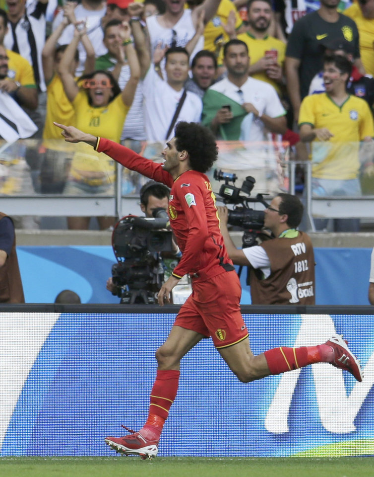 Photo - Belgium's Marouane Fellaini celebrates after scoring his side's first goal during the group H World Cup soccer match between Belgium and Algeria at the Mineirao Stadium in Belo Horizonte, Brazil, Tuesday, June 17, 2014.  (AP Photo/Petr David Josek)