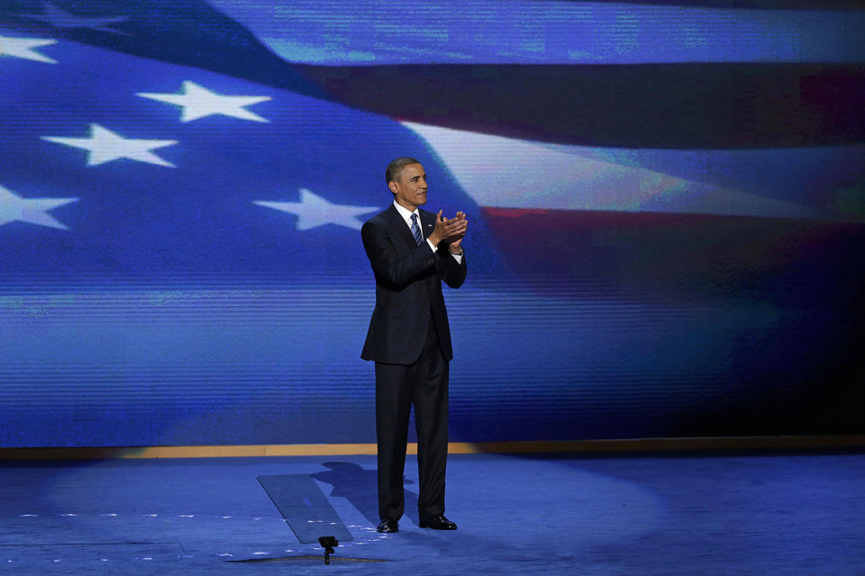 Photo -   President Barack Obama stands on stage after addressing the Democratic National Convention in Charlotte, N.C., on Thursday, Sept. 6, 2012. (AP Photo/J. Scott Applewhite)