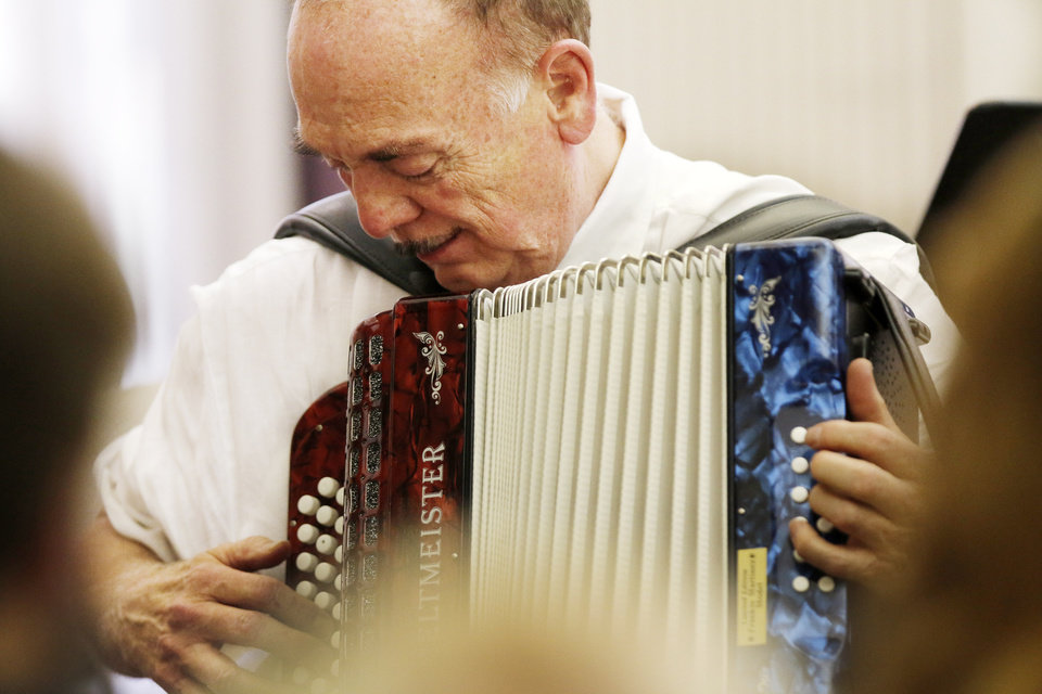 Photo -  Bob Mansfield plays the accordion. Photo by Doug Hoke, The Oklahoman   DOUG HOKE