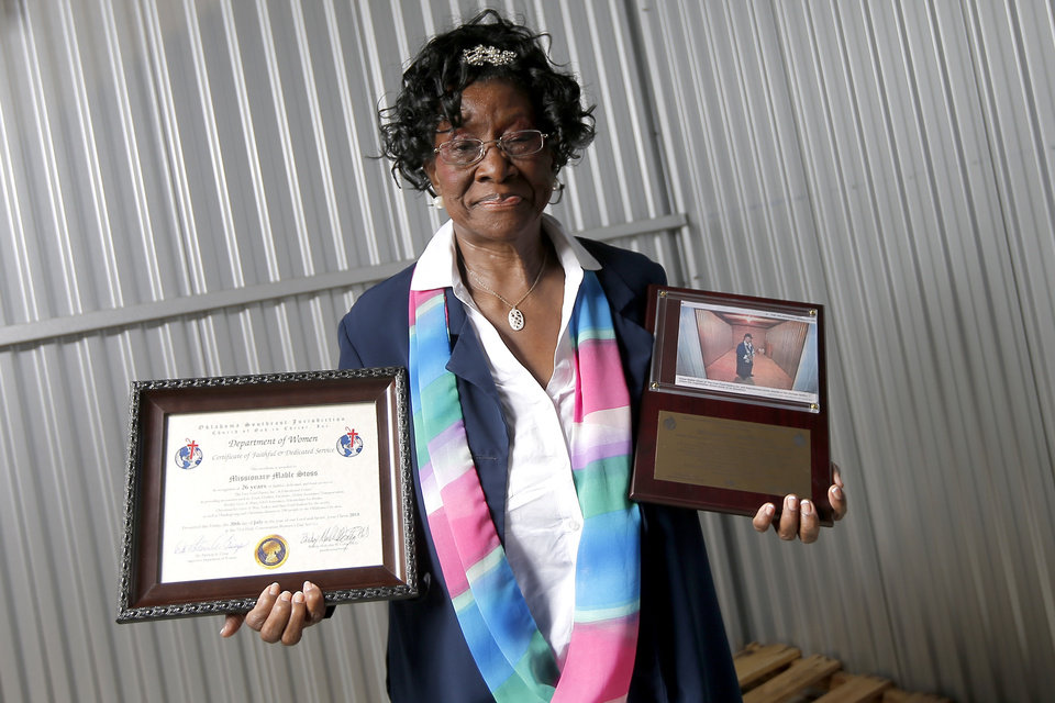 Photo -  Mable Stoss poses for a photo with two recent awards. [PHOTO BY BRYAN TERRY, THE OKLAHOMAN]