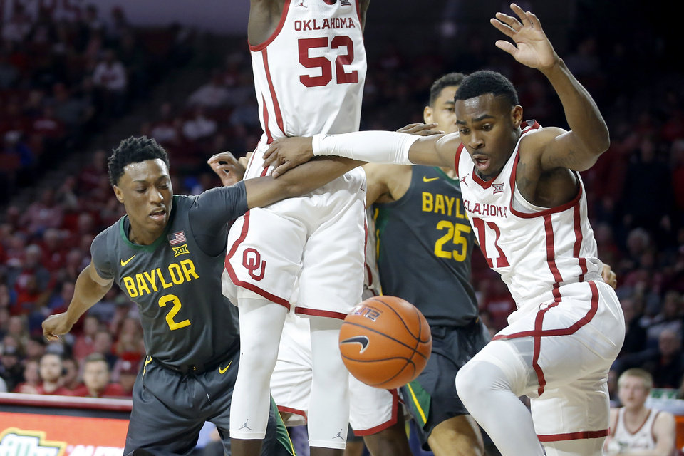 Photo - Oklahoma's De'Vion Harmon (11) and Baylor's Devonte Bandoo (2) go for the ball during a men's NCAA basketball game between the University of Oklahoma Sooners (OU) and the Baylor Bears at the Lloyd Noble Center in Norman, Okla., Tuesday, Feb. 18, 2020. [Bryan Terry/The Oklahoman]