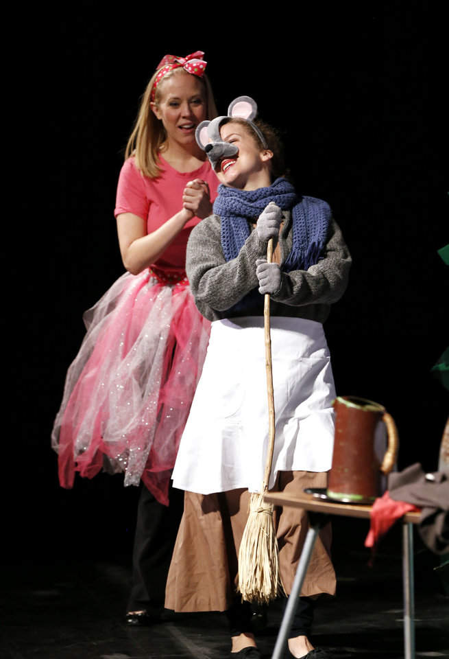 Photo - Miss Mouse, played by Suzanne Stanley, sings to Fumbelina, portrayed by Kristin Fitzgerald, in a Cimarron Opera Company performance Thursday of