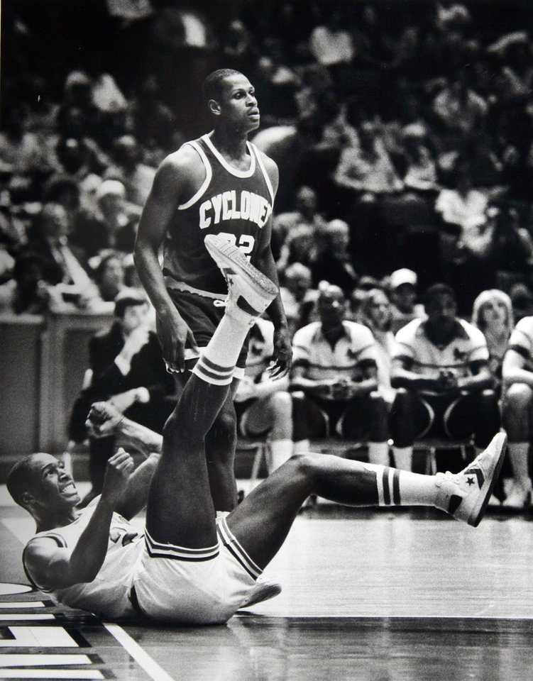 Former OU basketball player Wayman Tisdale. On the deck after being fouled, Wayman Tisdale exhorts his shot through the basket and later rides high in celebration. Staff photo by Doug Hoke. Photo taken 2/25/1984, Photo published 2/26/1984 in The Daily Oklahoman. ORG XMIT: KOD