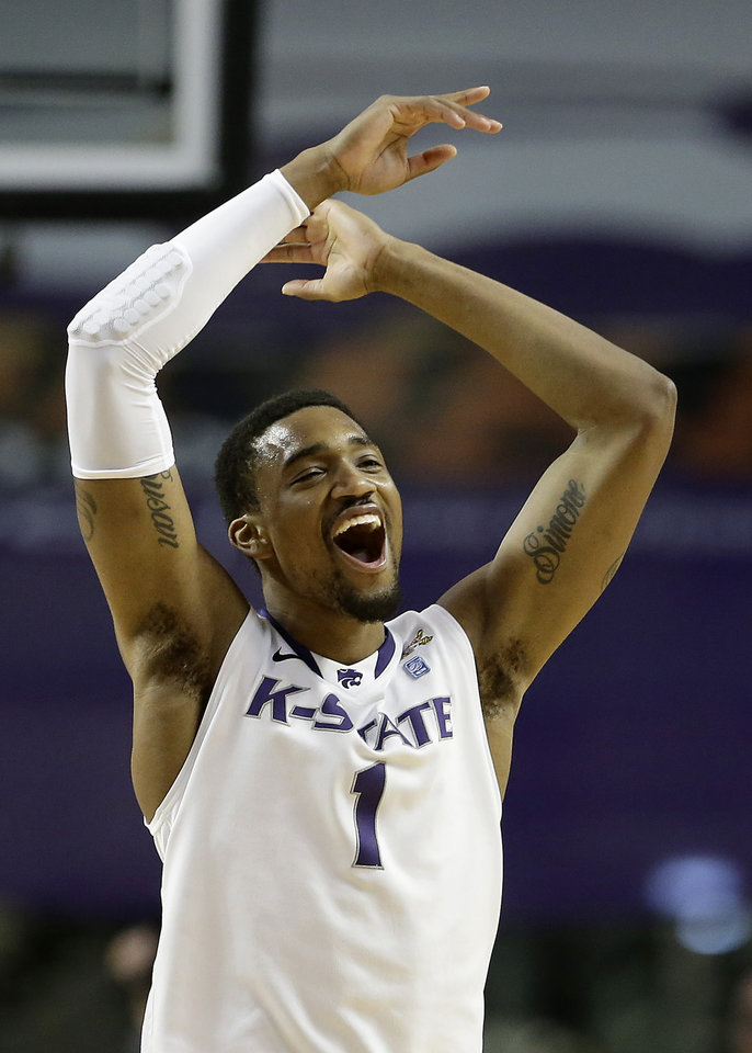 Photo - Kansas State's Shane Southwell celebrates a teammate's basket during the first half of an NCAA college basketball game against West Virginia Saturday, Jan. 18, 2014, in Manhattan, Kan. (AP Photo/Charlie Riedel)