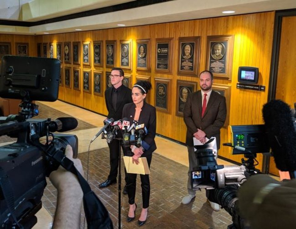 Photo -  Levi Hilliard,  Sara Bana and Jess Eddy speak to the media at Friday's special meeting of the University of Oklahoma Board of Regents. Hilliard and Eddy are asking for an investigation into OU's Title IX office. [Adam Kemp/The Oklahoman]