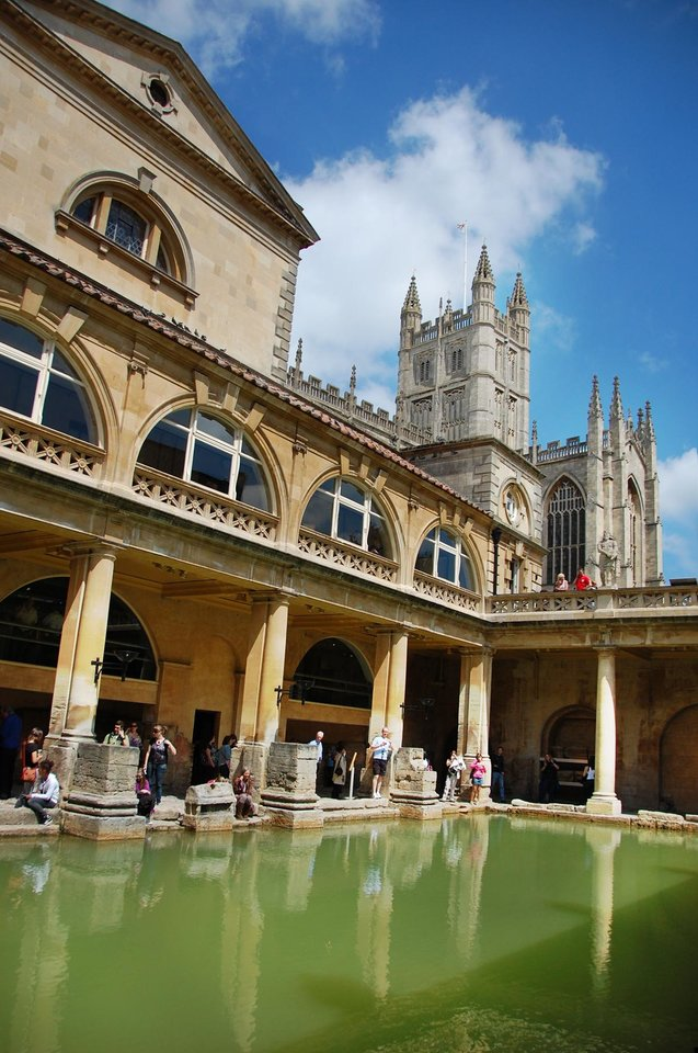 Photo -   The Great Bath, fed with hot spring water, was perfect for a luxurious swim in Roman times (notice Bath's abbey in the distance). (photo credit: Cameron Hewitt/Rick Steves' Europe)