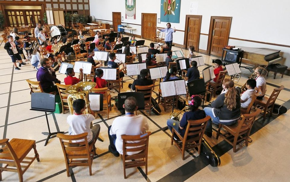 Photo - A beginning concert band rehearses during El Sistema Oklahoma after-school sessions at First Presbyterian Church, 1001 NW 25, in Oklahoma City, Friday, Aug. 17, 2018. [The Oklahoman Archives]