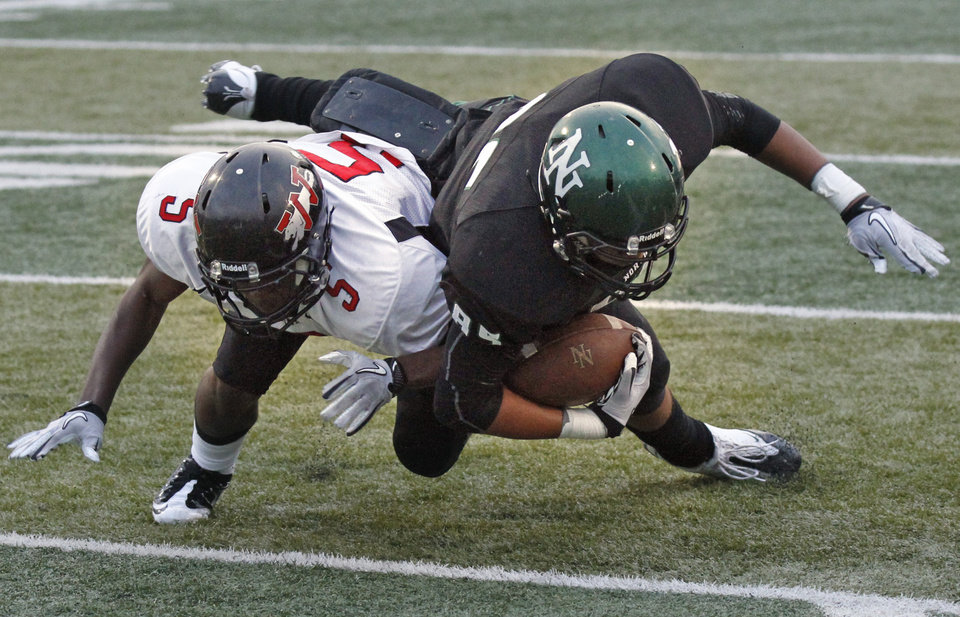 North's Payton Prince (85) stretches for the goal line as he scores on a reception past Jhames West (5) as the Norman North Timberwolves play the Westmoore Jaguars in high school football on Friday, September 16, 2011, in Norman, Okla.   Photo by Steve Sisney, The Oklahoman