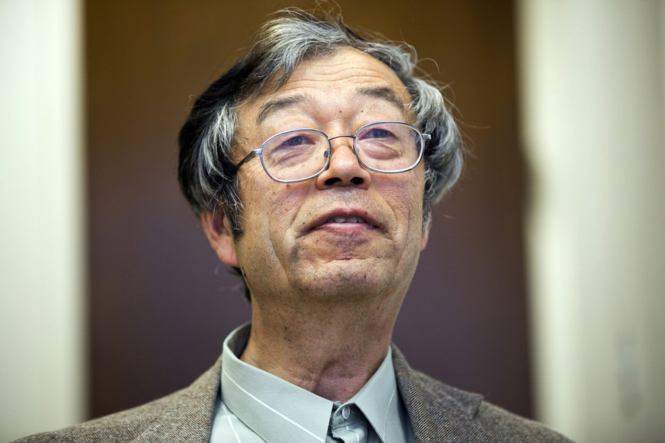 Photo - Dorian S. Nakamoto smiles during an interview with the Associated Press, Thursday, March 6, 2014 in Los Angeles. Nakamoto, the man that Newsweek claims is the founder of Bitcoin, denies he had anything to do with it and says he had never even heard of the digital currency until his son told him he had been contacted by a reporter three weeks ago. (AP Photo/Damian Dovarganes)
