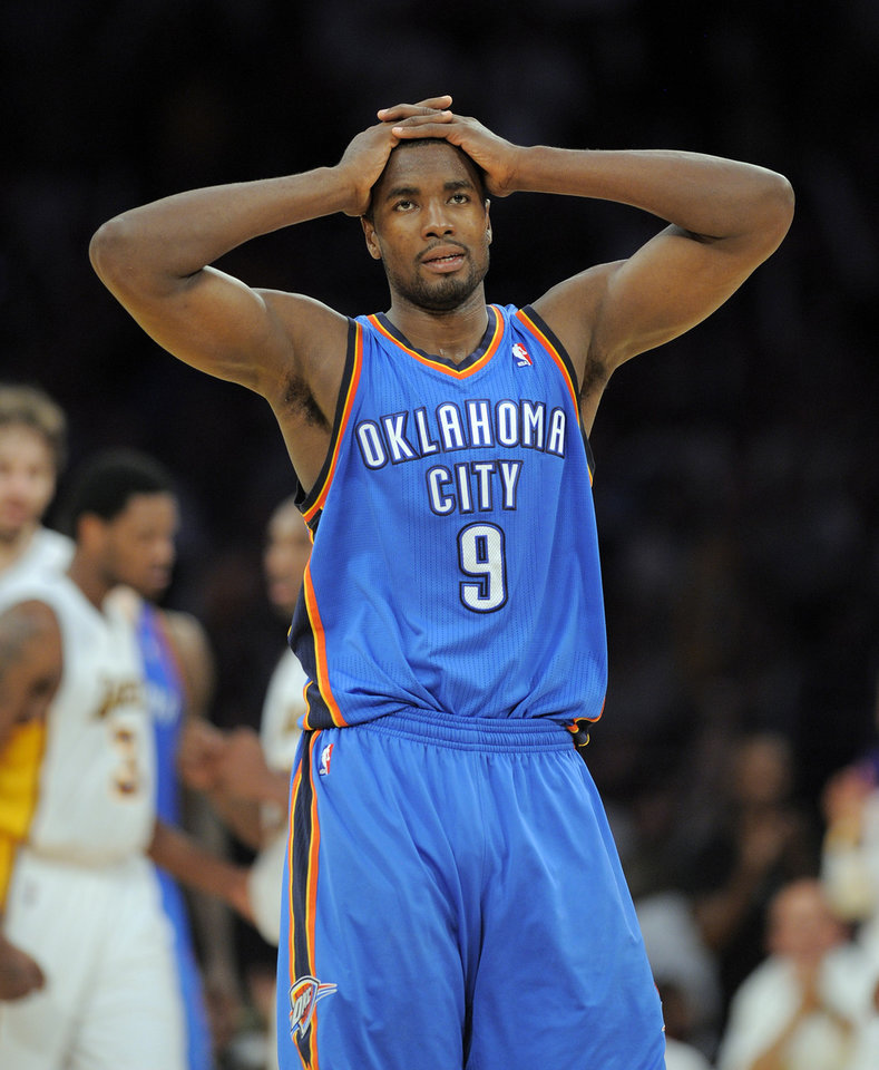 Oklahoma City Thunder forward Serge Ibaka reacts in the closing seconds of their NBA basketball game against the Los Angeles Lakers, Sunday, April 22, 2012, in Los Angeles. The Lakers won 114-106 in double overtime. (AP Photo/Mark J. Terrill)  ORG XMIT: LAS303