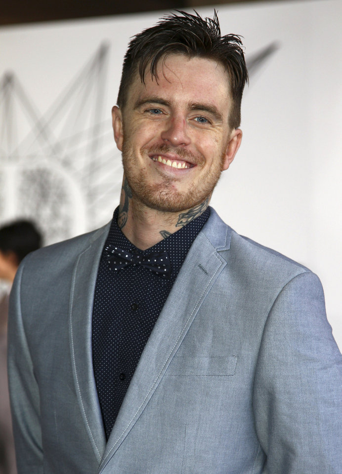 Matt Colwell, better known by his stage name 360, arrives for the Australian music industry Aria Awards in Sydney, Thursday, Nov. 29, 2012. (AP Photo/Rick Rycroft)