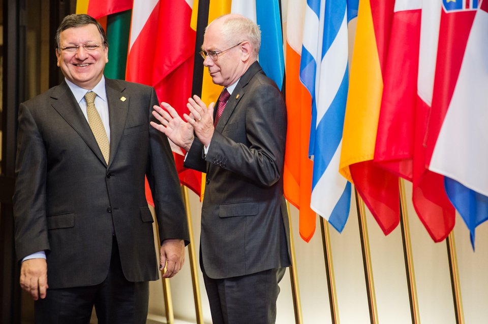 Photo - EU Commission President Jose Manuel Barroso, left, talks with EU Council President Herman Van Rompuy as they wait for the arrival of Ukraine's president during an EU summit in Brussels, Friday June 27, 2014. Ukrainian President Petro Poroshenko has signed up to a trade and economic pact with the European Union, saying it may be the