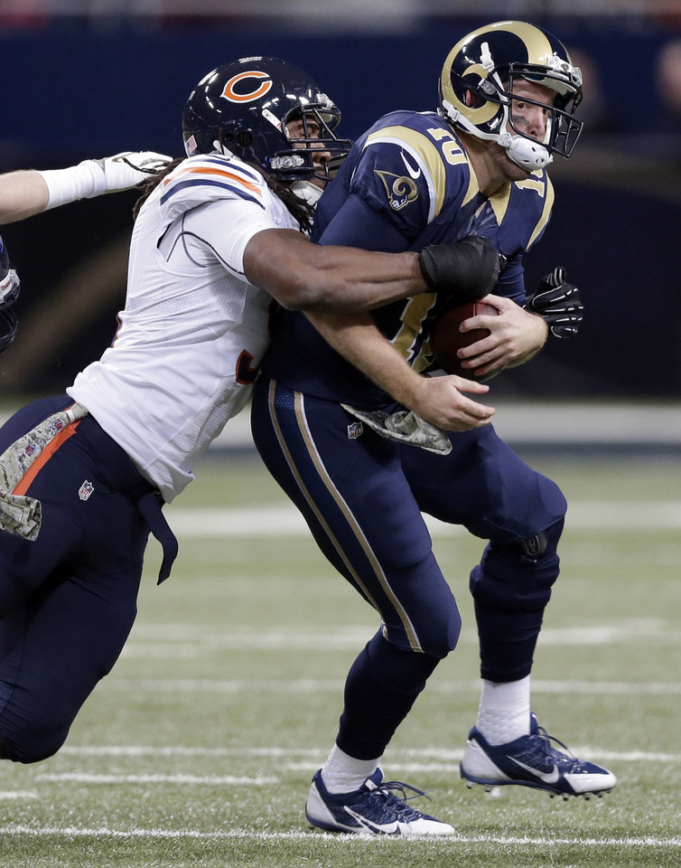 Photo - St. Louis Rams quarterback Kellen Clemens, right, is sacked by Chicago Bears defensive end David Bass for a 9-yard loss during the first quarter of an NFL football game on Sunday, Nov. 24, 2013, in St. Louis. (AP Photo/Nam Y. Huh)