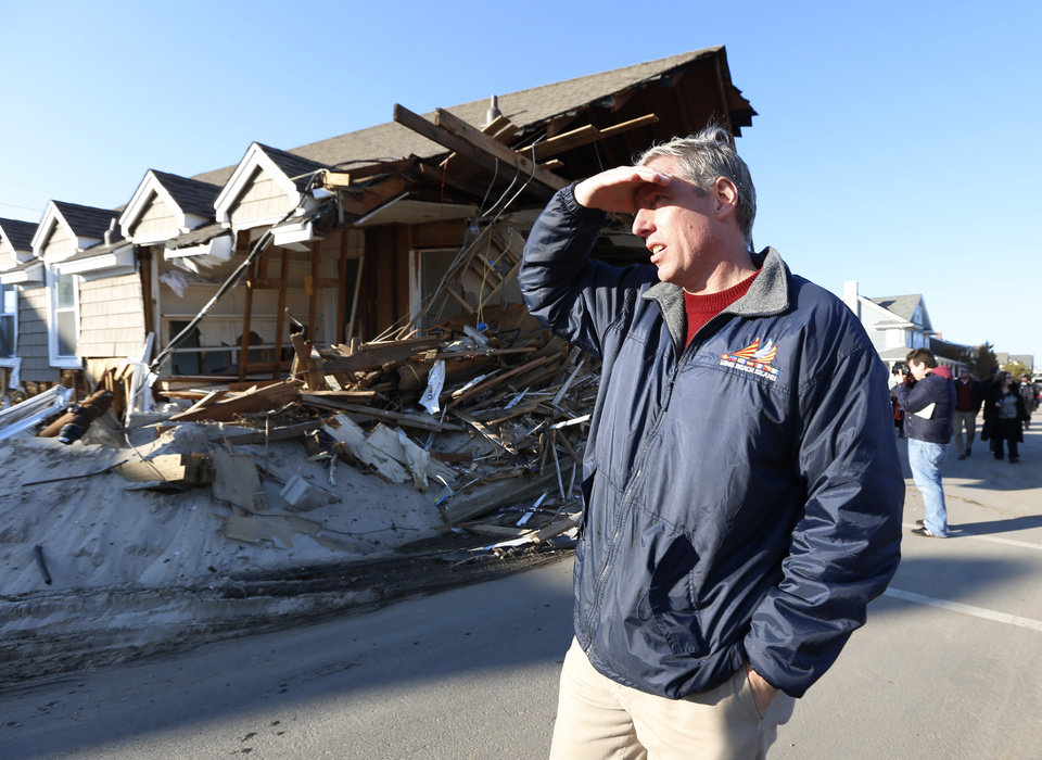New Jersey State Assemblyman Erik Petersen looks on near a home damaged by Superstorm Sandy, Thursday, Nov. 29, 2012, in Mantoloking, N.J. The New Jersey General Assembly took a tour of areas hit a month after the storm. (AP Photo/Julio Cortez)