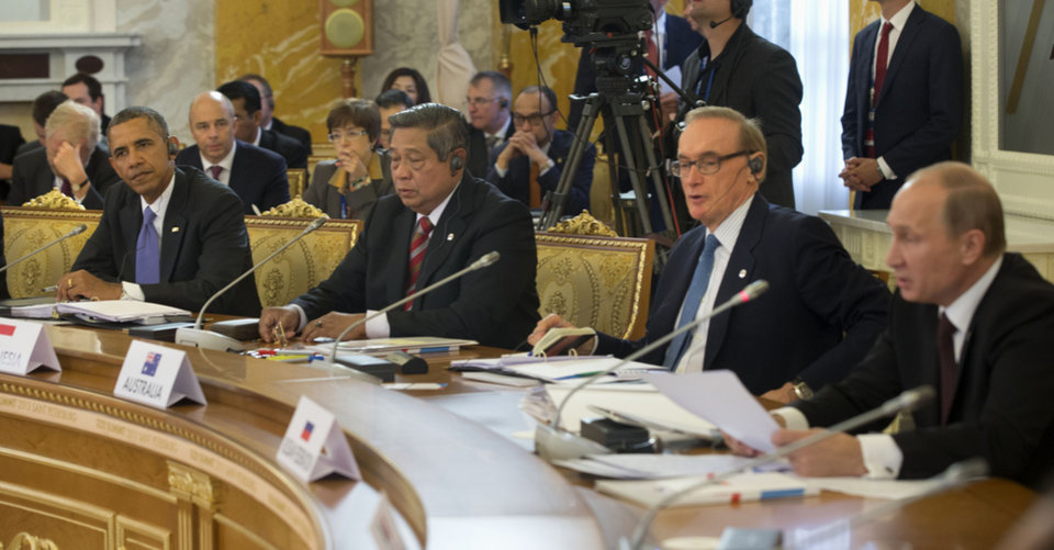 Photo - President Barack Obama listens at let as Russian President Vladimir Putin, far right, speaks during the start of the G-20 Working Session at the Konstantin Palace in St. Petersburg, Russia, Thursday, Sept. 5, 2013. From left are, the president, Indonesian President Susilo Bambang Yudhoyono, Australian Foreign Minister Bob Carr and Putin. (AP Photo/Pablo Martinez Monsivais/Pool)