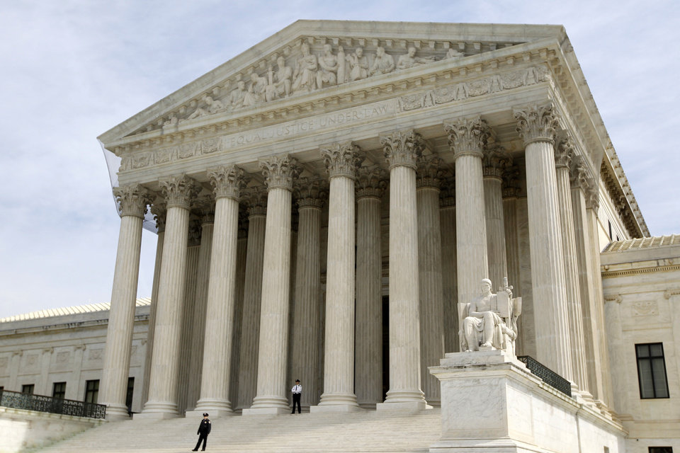 Photo -   FILE - In this March 28, 2012 file photo, the Supreme Court is seen in Washington. The Supreme Court won't reduce the $675,000 verdict against a Boston University student who illegally downloaded 30 songs and shared them on the Internet. (AP Photo/Charles Dharapak, File)