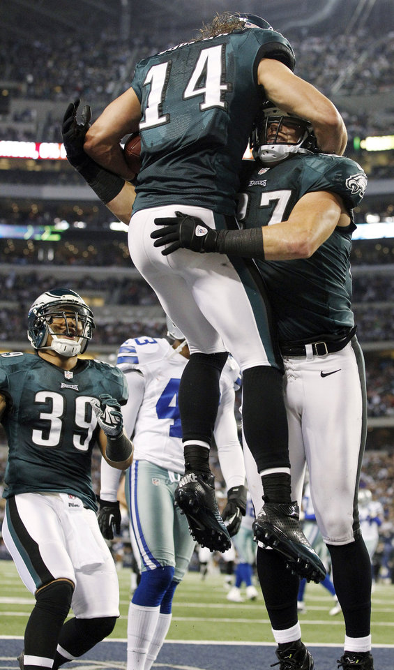 Photo - Philadelphia Eagles wide receiver Riley Cooper (14) celebrates with Brent Celek (87) and Stanley Havili (39) after scoring a touchdown against the Dallas Cowboys during the second half of an NFL football game, Sunday, Dec. 2, 2012, in Arlington, Texas. (AP Photo/Tony Gutierrez)