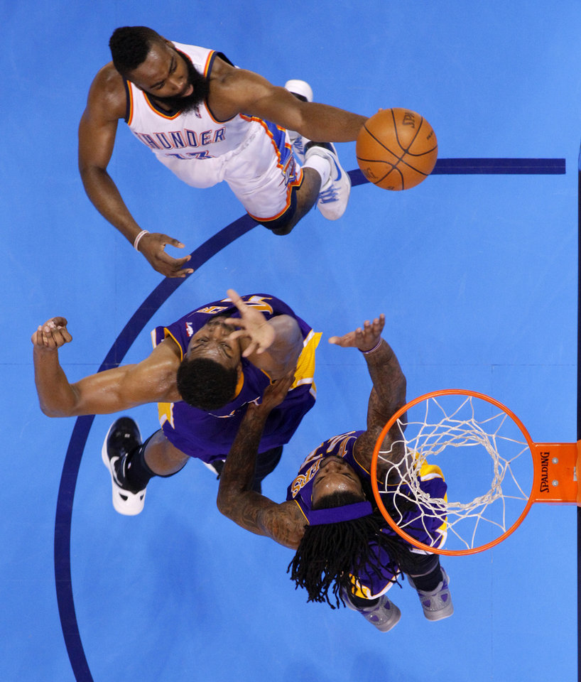 Oklahoma City's James Harden (13) goes to the basket beside Los Angeles' Andrew Bynum (17) and Jordan Hill (27) during Game 1 in the second round of the NBA playoffs between the Oklahoma City Thunder and L.A. Lakers at Chesapeake Energy Arena in Oklahoma City, Monday, May 14, 2012. Photo by Bryan Terry, The Oklahoman