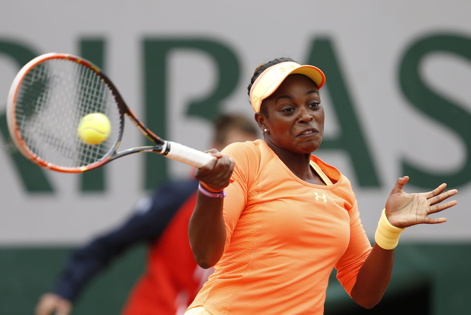 Photo - Sloane Stephens, of the U.S, returns the ball to China's Peng Shuai during the first round match of  the French Open tennis tournament at the Roland Garros stadium, in Paris, France, Tuesday, May 27, 2014. (AP Photo/Darko Vojinovic)