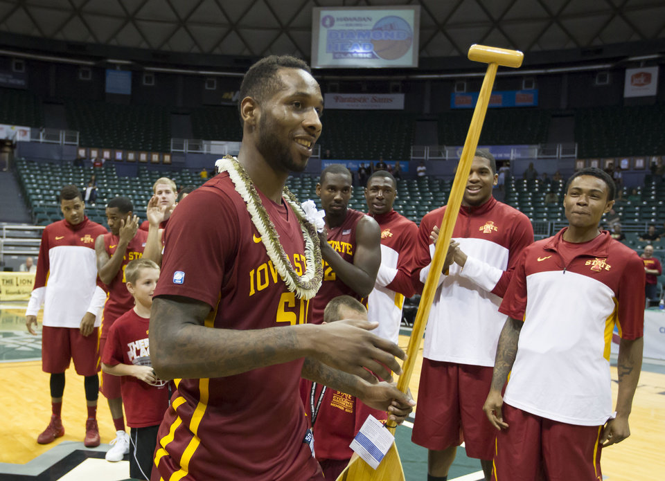 Photo - Iowa State guard DeAndre Kane (50) holds the award after being most valuable player at the Diamond Head Classic on Wednesday, Dec. 25, 2013, in Honolulu. Iowa State defeated Boise State 70-66 in an NCAA college basketball game to win the tourney. (AP Photo/Eugene Tanner)