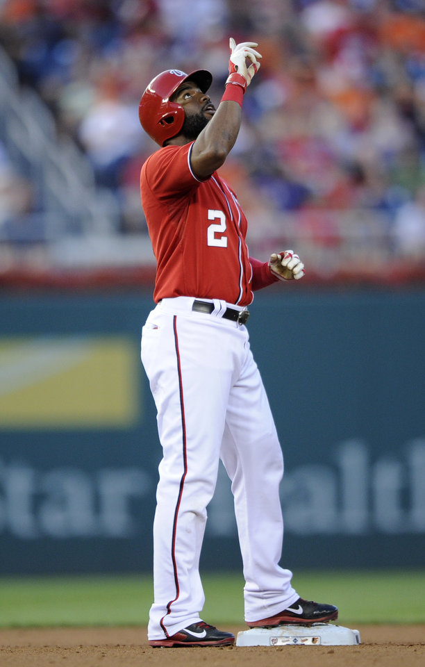 Photo - Washington Nationals' Denard Span gestures after he doubled against the Baltimore Orioles during the third inning of a baseball game, Monday, Aug. 4, 2014, in Washington. (AP Photo/Nick Wass)
