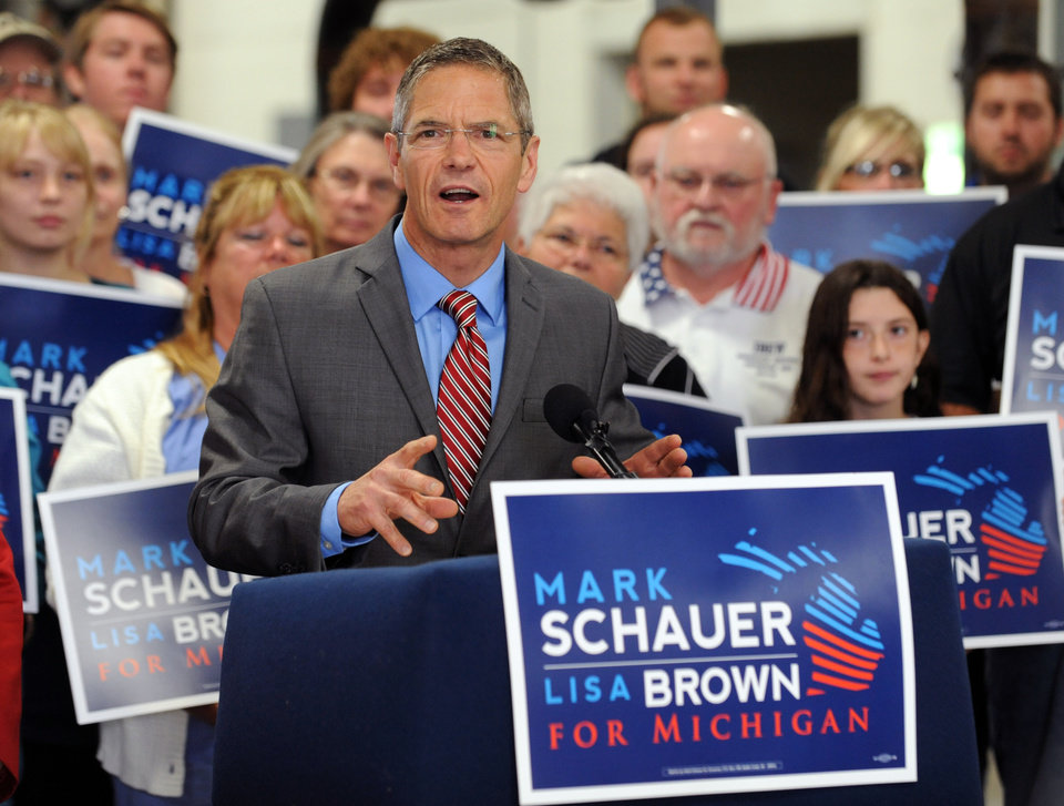 Photo - Democratic gubernatorial candidate Mark Schauer unveils his 10-point jobs plan at a news conference held at the Plumbers and Pipefitters Local 333 training facility in Lansing, Mich. on Tuesday, July 29, 2014. (AP Photo/Lansing State Journal, Greg DeRuiter)