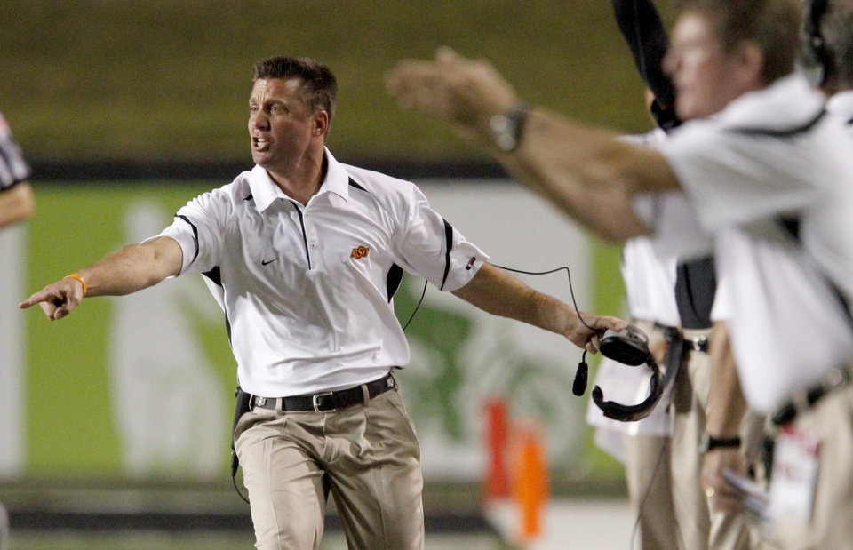 Photo - OSU coach Mike Gundy reacts after a play during the football game between the University of Louisiana-Lafayette and Oklahoma State University at Cajun Field in Lafayette, La., Friday, October 8, 2010. Photo by Bryan Terry, The Oklahoman