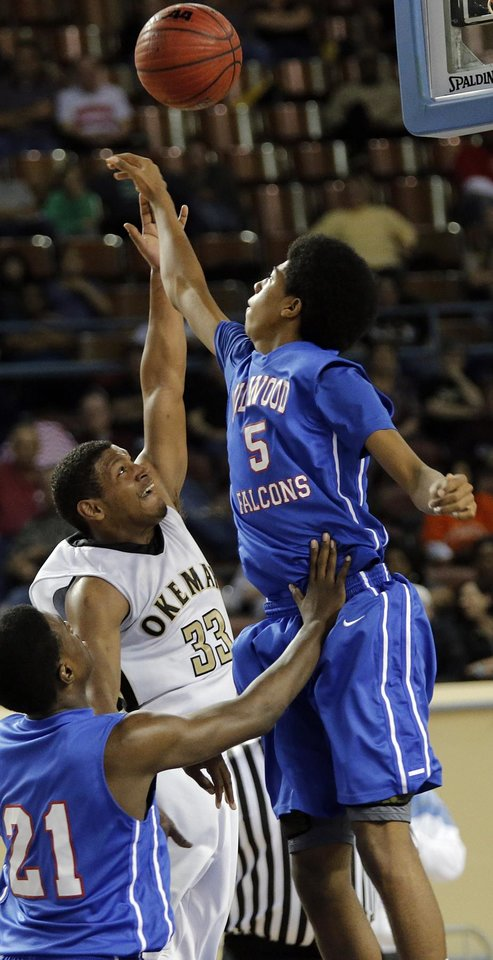 Millwood's Ashford Golden (5) puts up a shot over Okemah's Stoney Newton (33) during the state high school basketball tournament Class 3A boys championship game between Millwood High School and Okemah High School at the State Fair Arena on Saturday, March 9, 2013, in Oklahoma City, Okla. Photo by Chris Landsberger, The Oklahoman