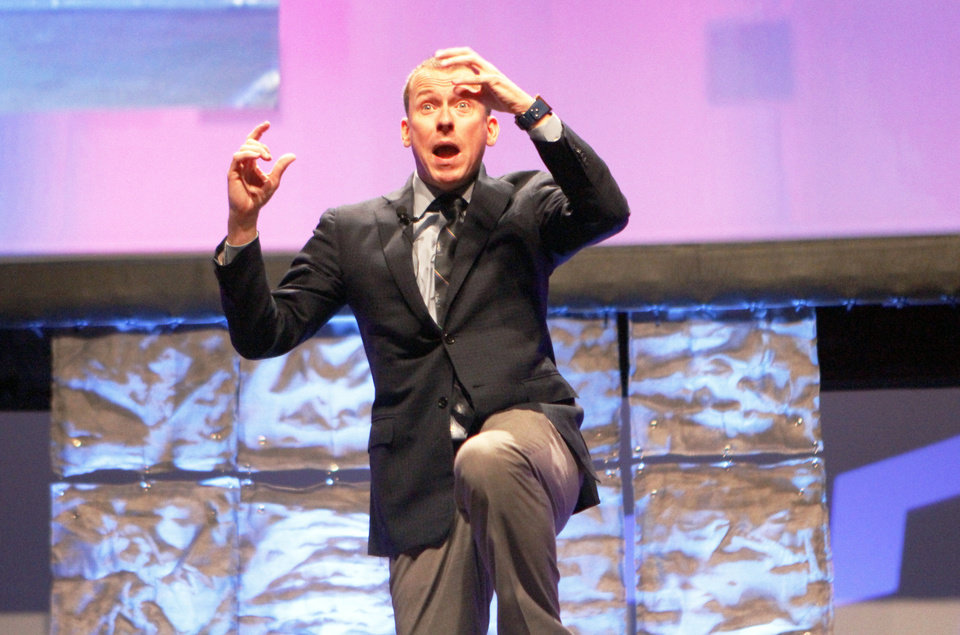 Photo - Keynote speaker Ron Clark gives his presentation at the Vision 2020 teachers conference on Wednesday. The conference coincided with the state Education Department announcing the names of the state's 12 teacher of the year finalists. PHOTO BY ALIKI DYER, THE OKLAHOMAN  Aliki Dyer