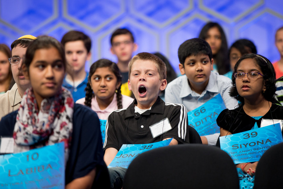 Photo - Jonathon Schafer, 13, of Naples, Fla., center, yawns during the 2015 Scripps National Spelling Bee, Wednesday, May 27, 2015, at National Harbor in Oxon Hill, Md. (AP Photo/Andrew Harnik)
