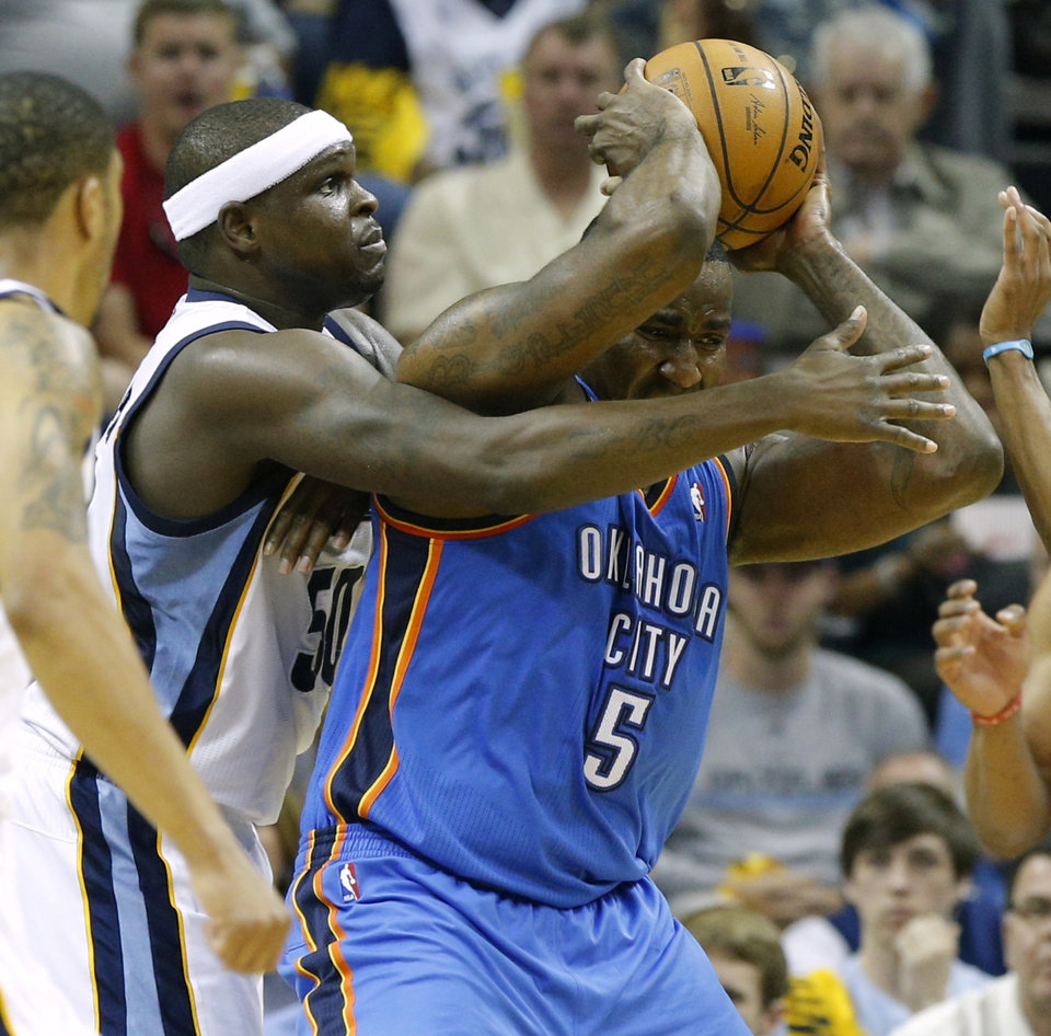 Photo - Oklahoma City's Kendrick Perkins is defended by Memphis' Zach Randolph during Game 4 in the first round of the NBA playoffs between the Oklahoma City Thunder and the Memphis Grizzlies at FedExForum in Memphis, Tenn., Saturday, April 26, 2014. Photo by Bryan Terry, The Oklahoman