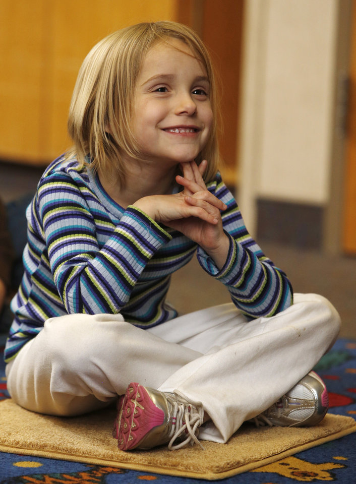 Emma Morris, 6, listens to a story during the  Afterschool Special at the Norman Public Library  on Wednesday, Jan. 16, 2013 in Norman, Okla.  Photo by Steve Sisney, The Oklahoman